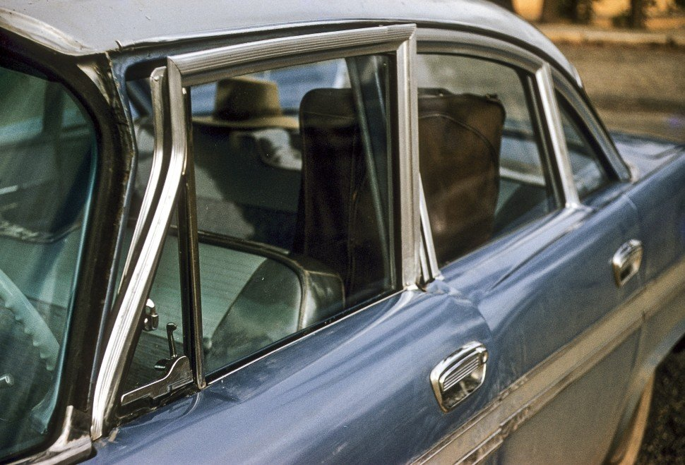Free image of Close up of the deformed door of a vintage car.