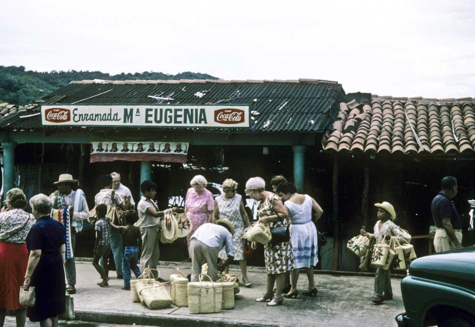 Free image of Tourists in a marketplace in Mexico