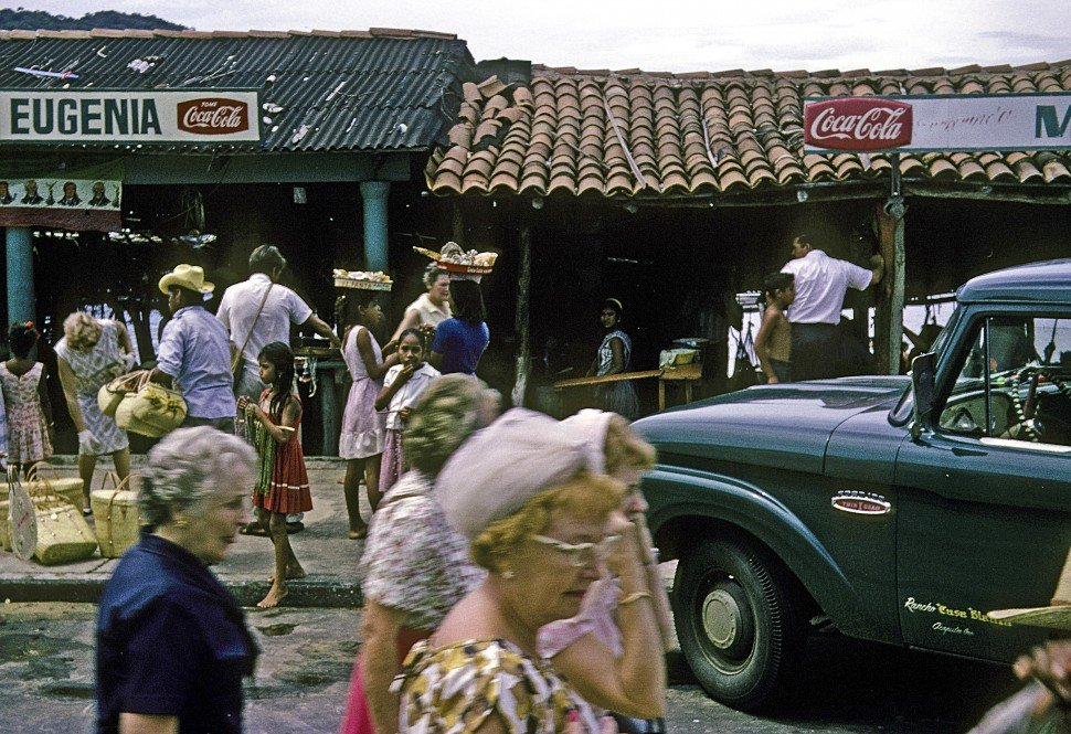 Free image of Tourists in a Mexican marketplace.