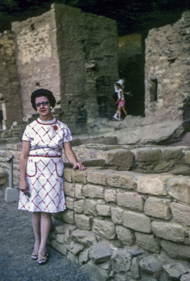 Free image of Woman posing in front of ancient ruins, USA