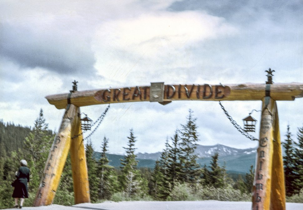 Free image of Woman standing at the entrance to the Great Divide, British Columbia