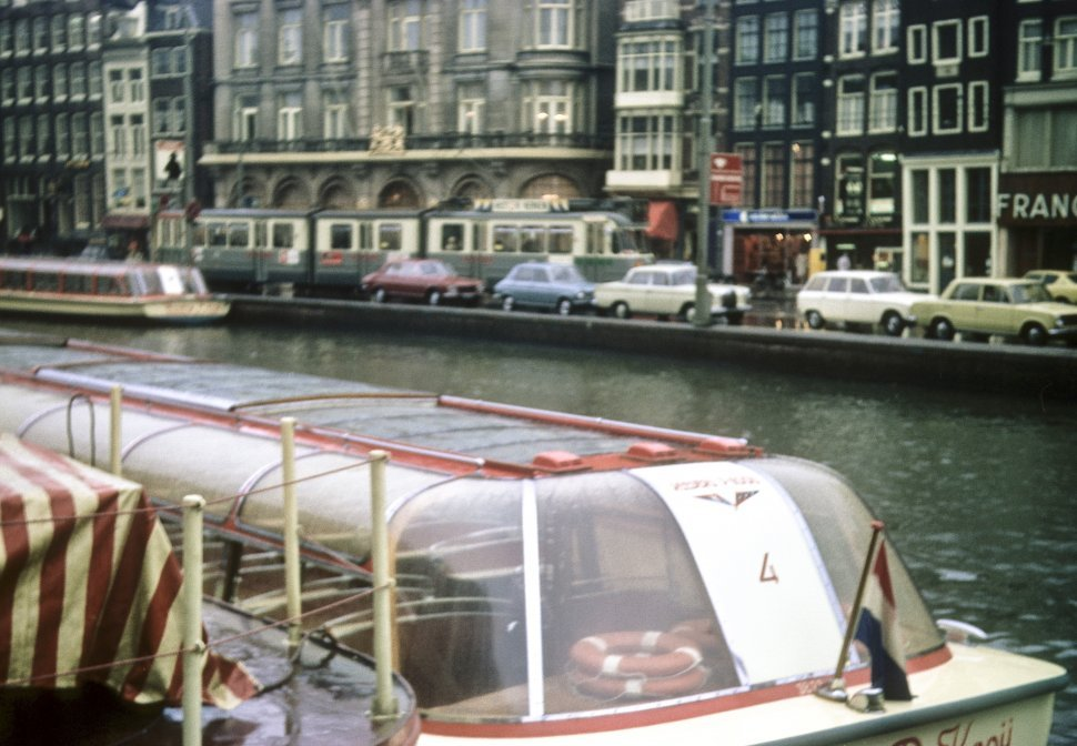 Free image of An empty ferry boat in a canal, Amsterdam, Netherlands