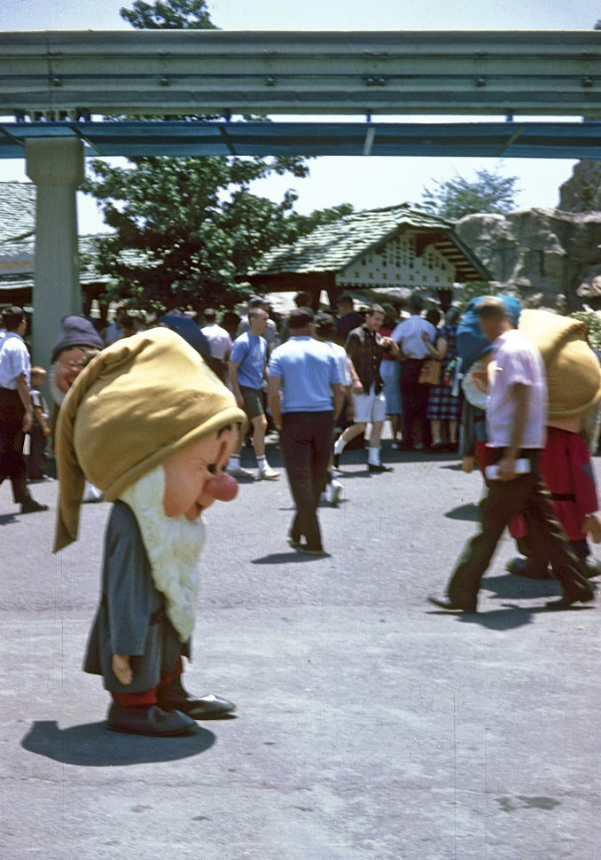 Free image of Crowd of people and dwarf character at Disneyland, Anaheim, California, USA