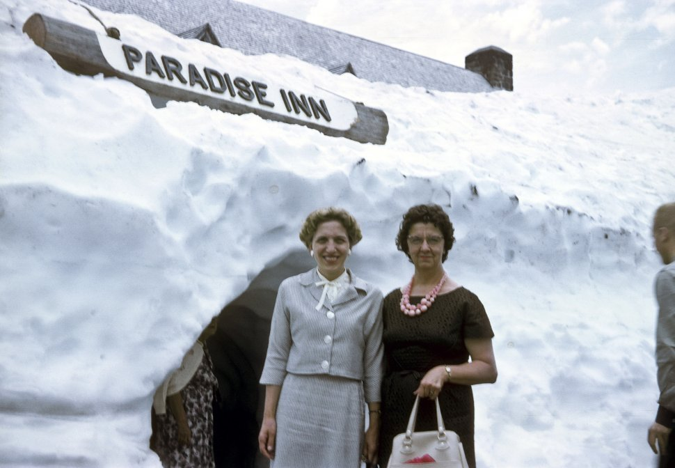 Free image of Two woman posing at the entrance of the Paradise Inn in Mount Rainier National Park in Washington State, USA