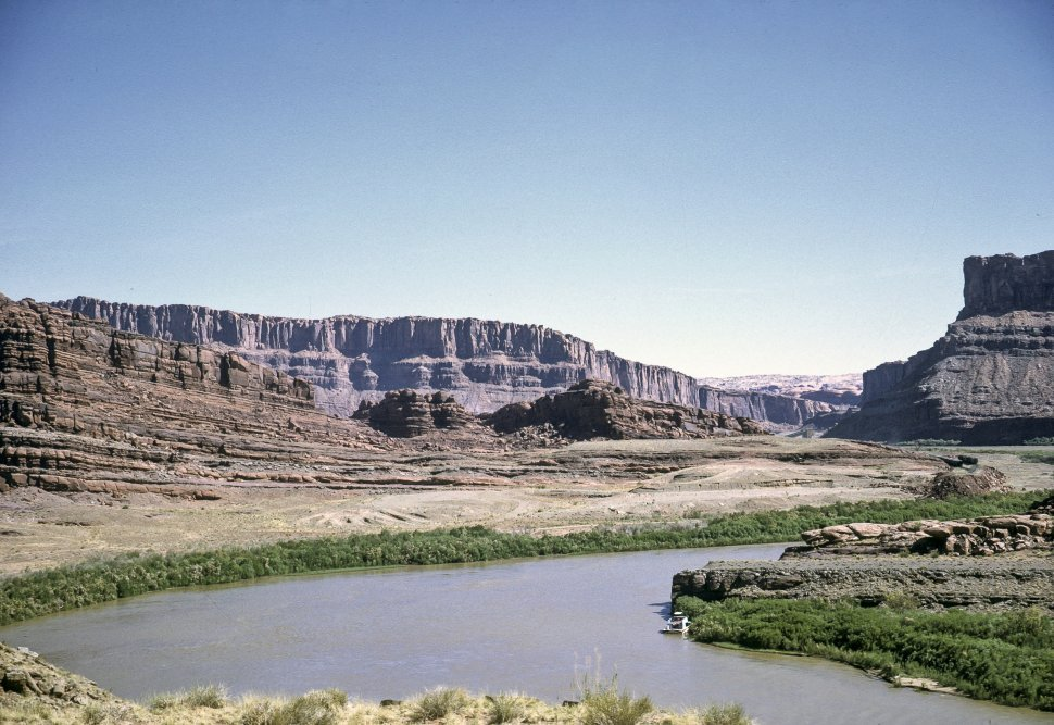 Free image of View of a river running through a canyon valley, circa 1969, southwestern USA