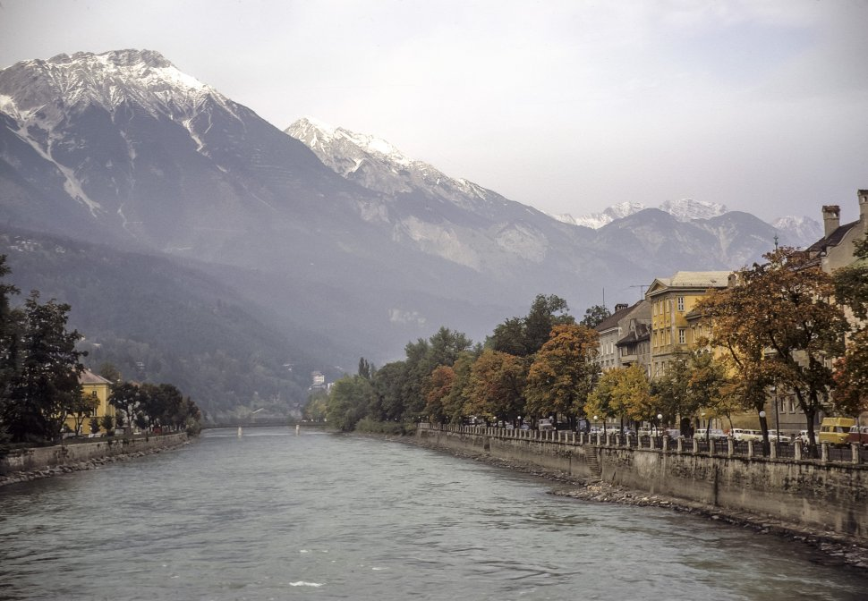 Free image of Scenic landscape view of a river front and snow capped mountains.