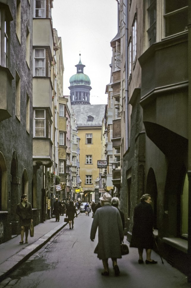 Free image of People walking down a small street in East Berlin, Germany