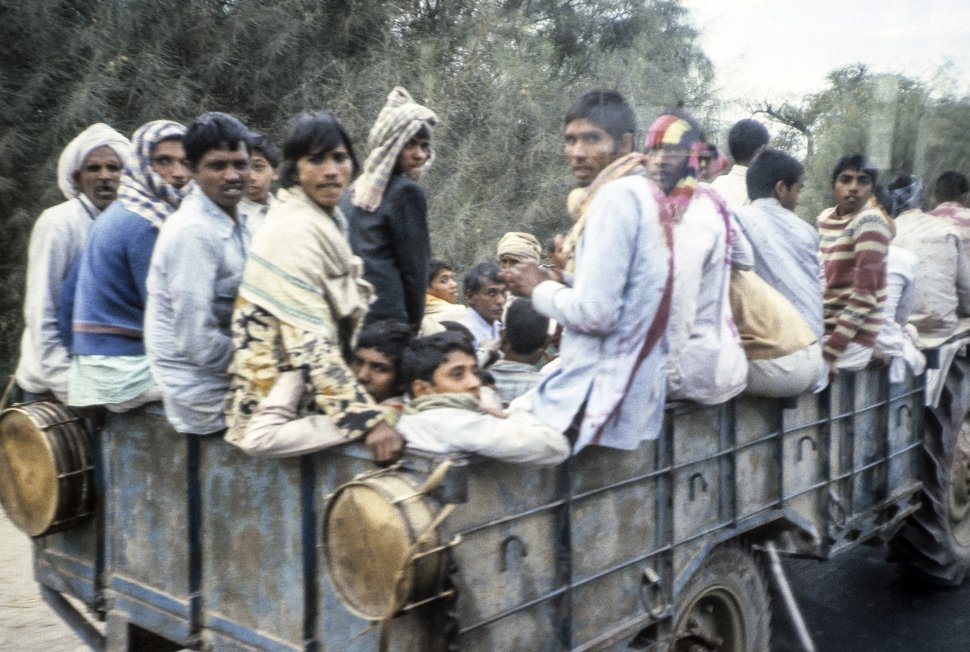 Free image of Workers travelling the  back of a truck, India