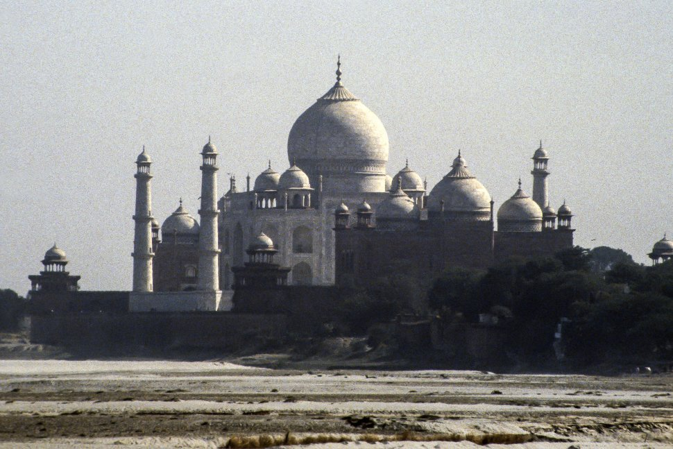Free image of Taj Majal in the distance on a beach, India