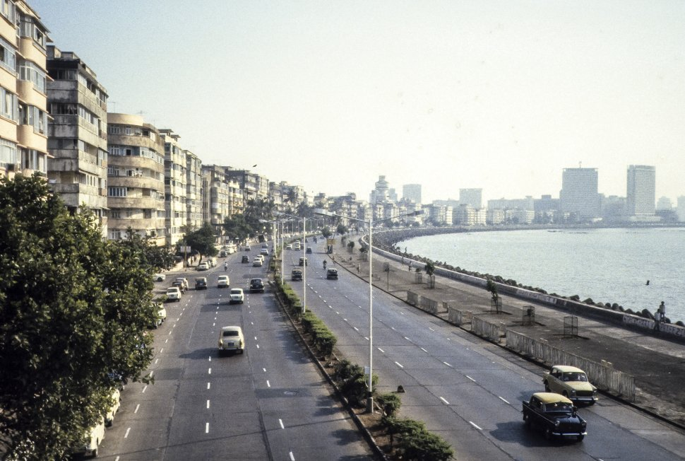 Free image of Traffic travelling along a seawall, India
