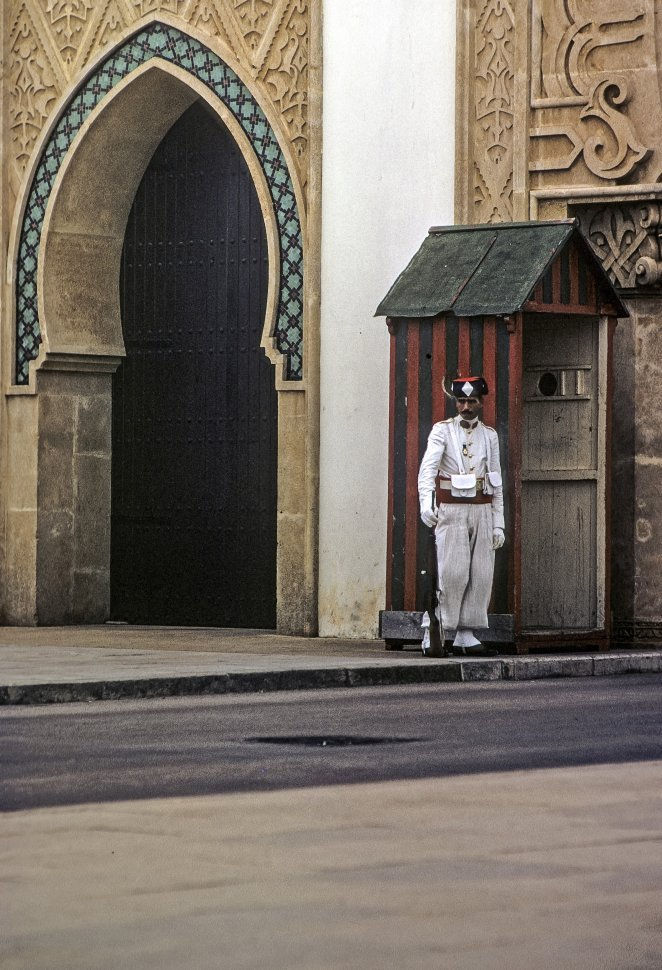 Free image of Guard protecting the archway of a building, circa 1971, Morocco, Africa