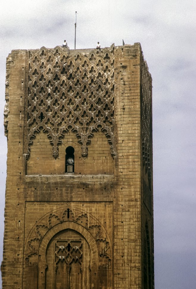 Free image of People standing in the window of an ancient tower, circa 1971, Morocco, Africa
