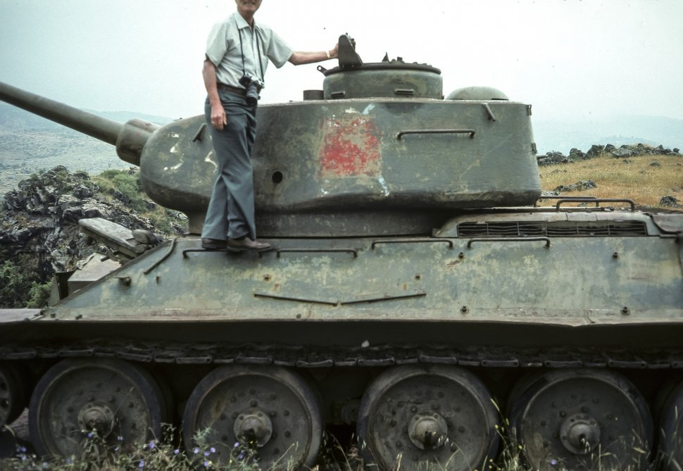 Free image of Man posing on top of an Israeli tank on a hillside, circa 1976, Israel