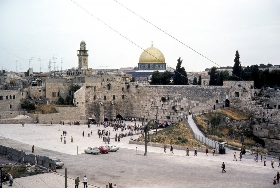 Free image of Temple Mount and Wailing Wall with a large group of people walking through the parking lot, circa 1976, Israel