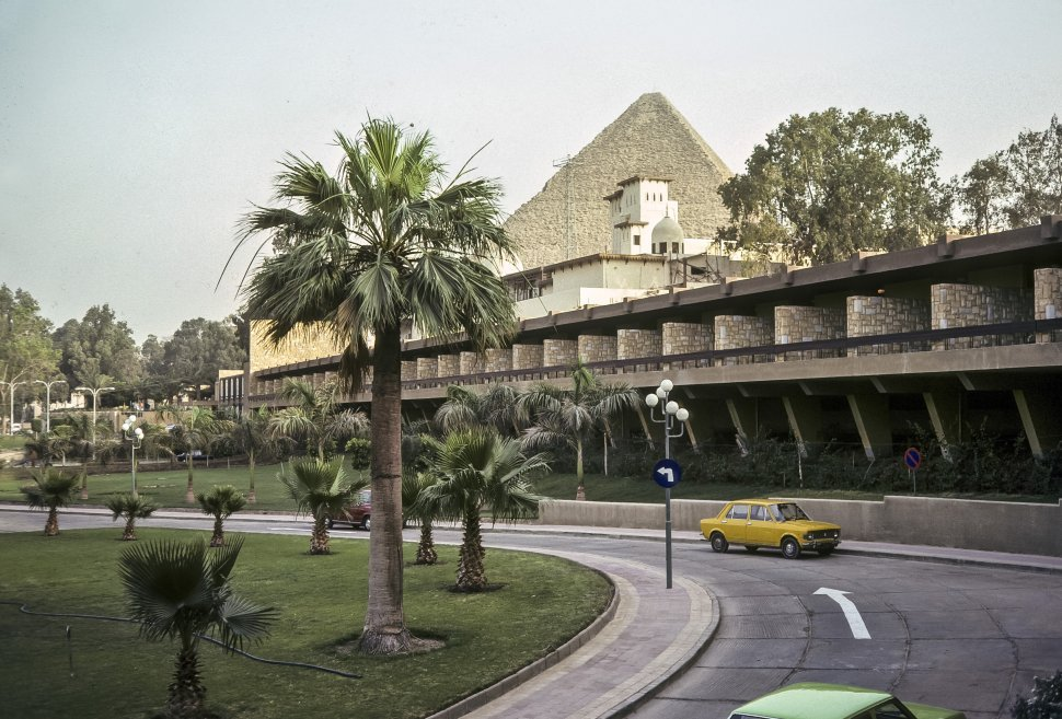 Free image of Contrasting architecture with one of The Great Pyramids in the background, circa 1976, Egypt