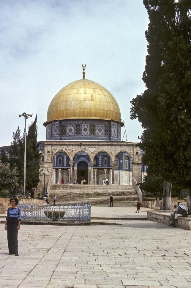 Free image of Woman posing in a courtyard, in front of the Dome of the Rock, circa 1976, Israel