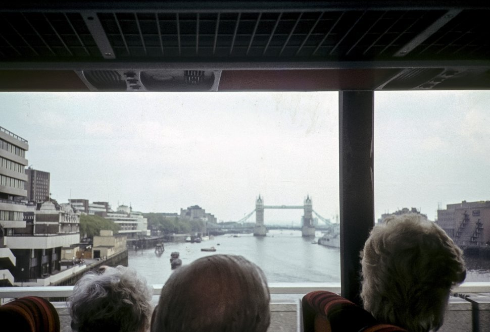 Free image of Group of people on a tour bus looking out the window at the London Bridge, London, England