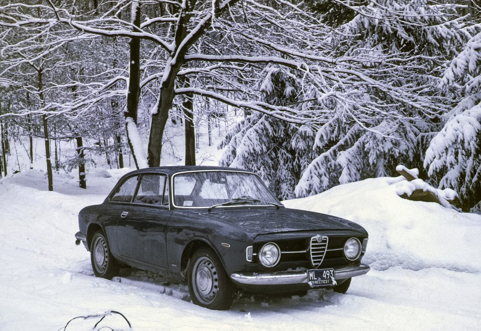 Free image of Car parked in a snowy forest.