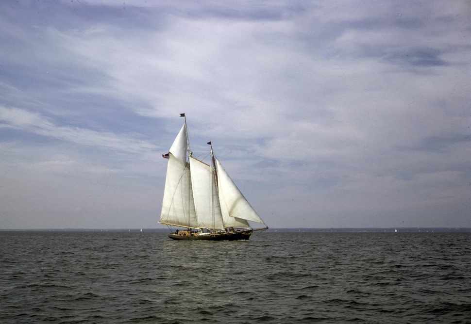 Free image of Large antique boat sailing in the distance.