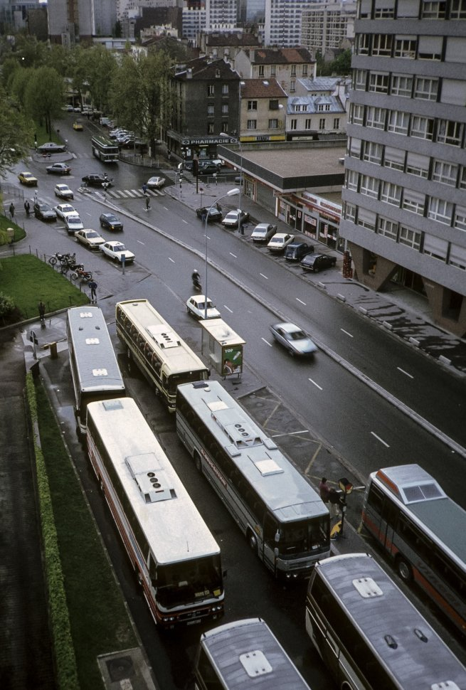 Free image of Buses and traffic on a crowded city street.