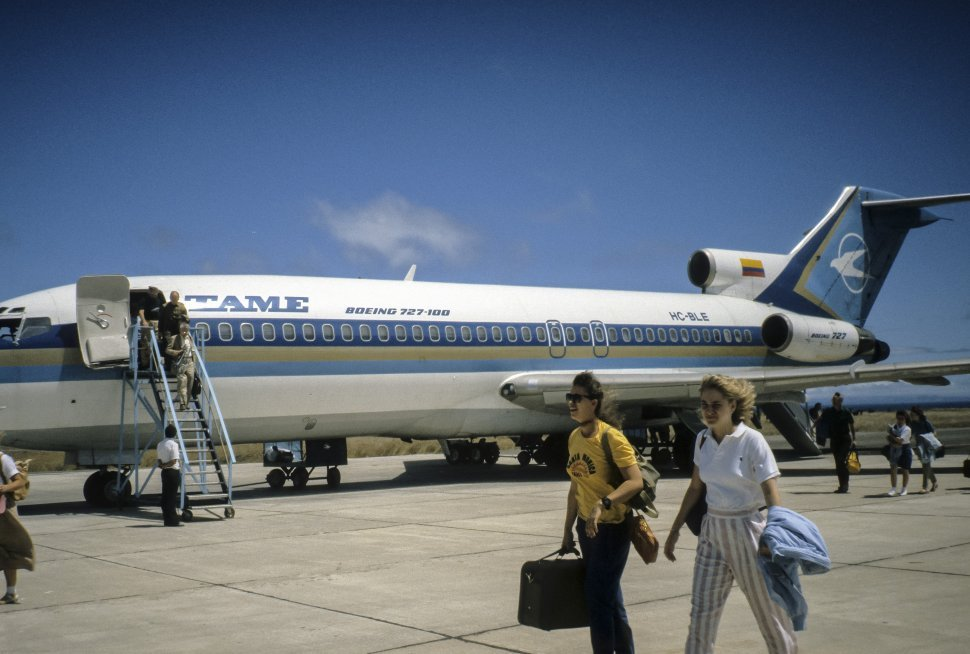 Free image of Group of people boarding a plane on a runway.
