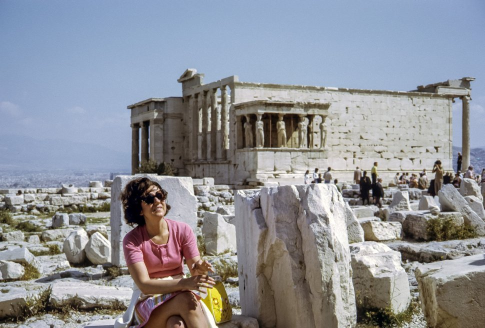 Free image of Woman posing in front of ancient Caryatid Porch of the Erechtheion, Athens, Greece