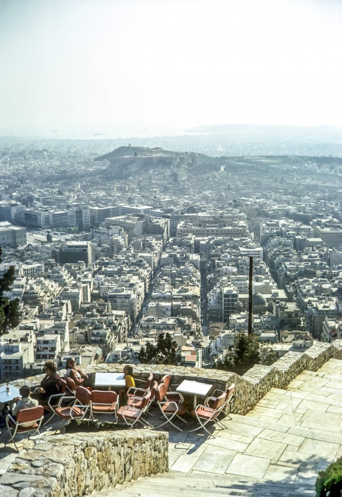 Free image of Group of people dining at a resturant with a sweeping vista, Athens, Greece