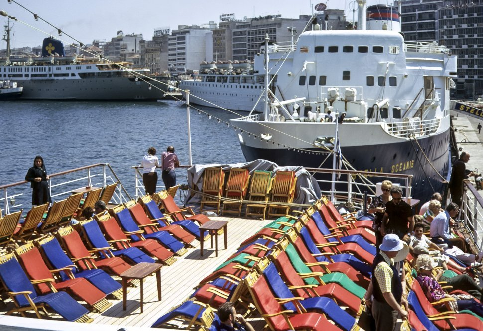 Free image of Tourists sitting in sun chairs on the deck of a cruise ship, Europe