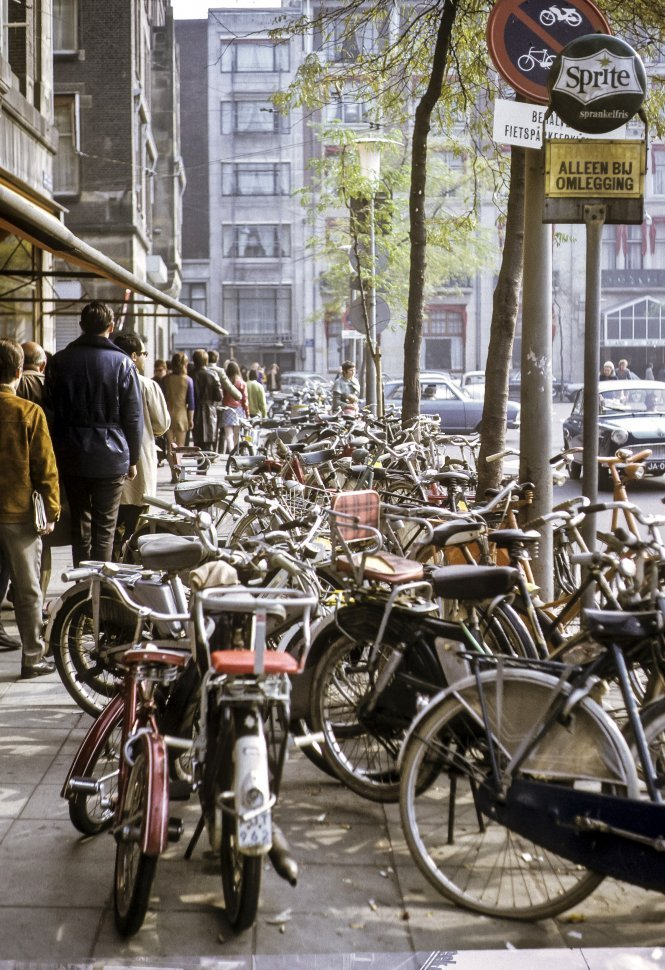 Free image of Large group of bicycles, parked along a city street, Europe
