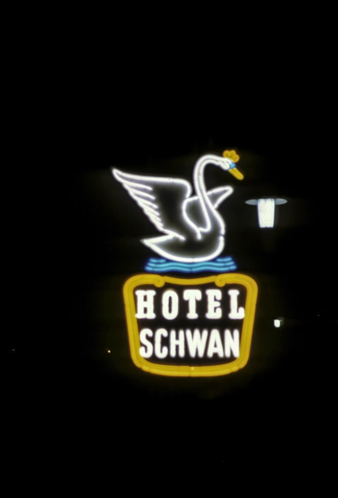 Free image of Image of a bright neon sign for the Hotel Schwan, Germany