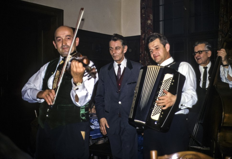 Free image of Group of musicians playing as they walk through a room, Europe