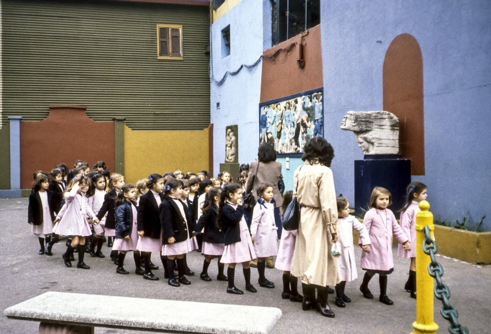 Free image of Group of school children walking through a school yard with their teacher, Europe