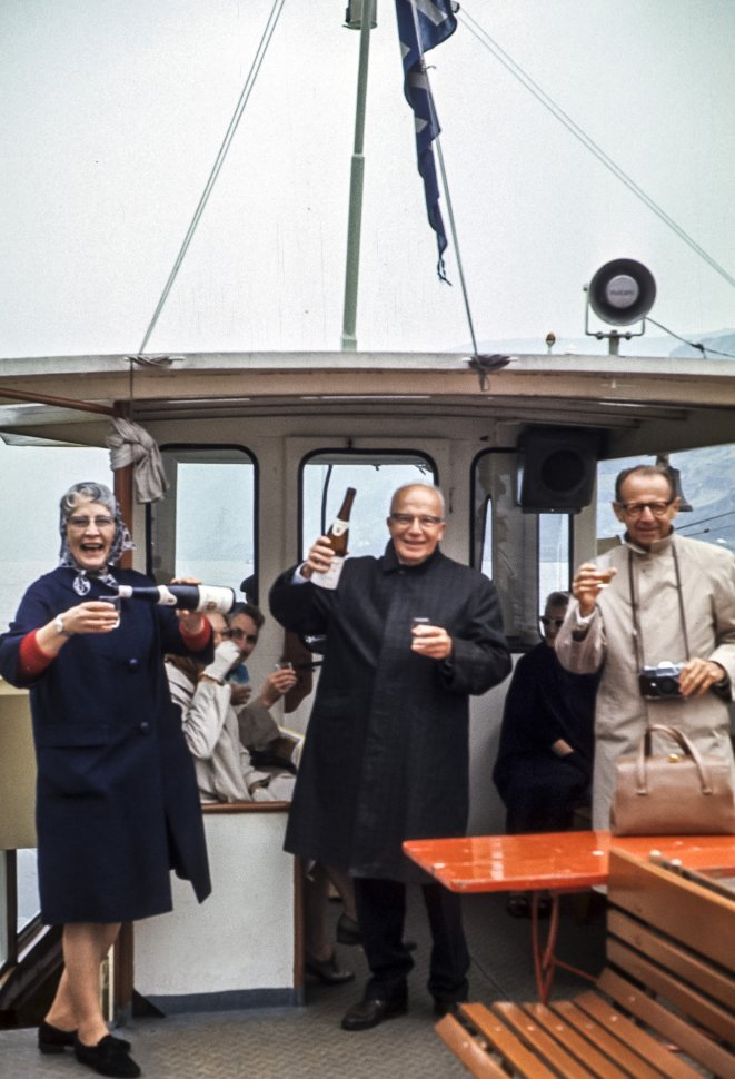 Free image of Group of tourists on a boat toasting the camera, Europe