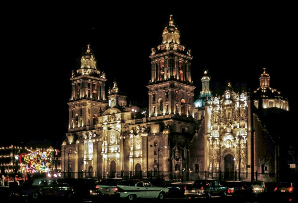 Free image of Cars parked in front of a Metropolitan Cathedral and light display at night. Mexico City, Mexico.