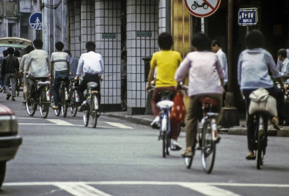 Free image of People riding their bicycles through traffic, Asia
