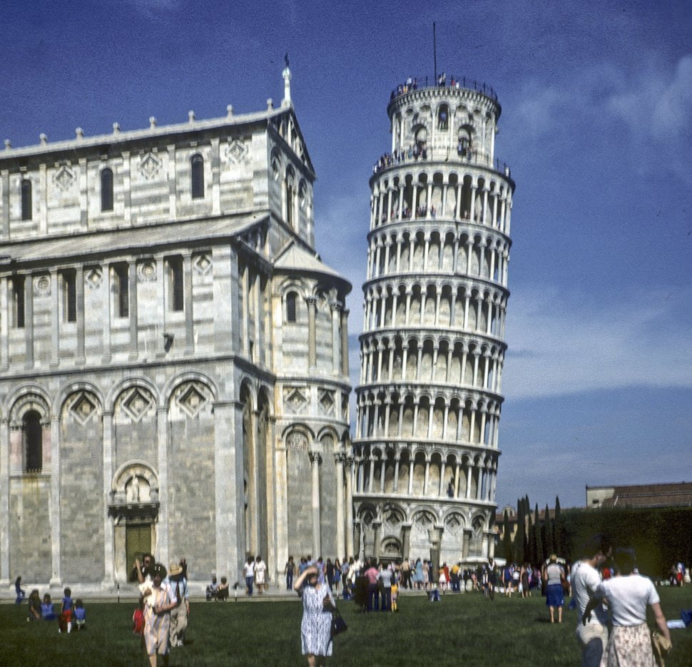 Free image of Tourists walking around the Leaning Tower of Pisa, Italy