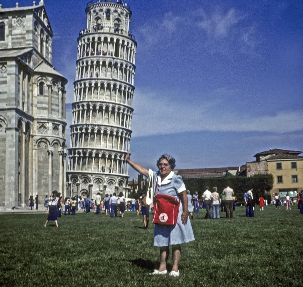 Free image of Woman pretending to hold up the Leaning Tower of Pisa, Italy