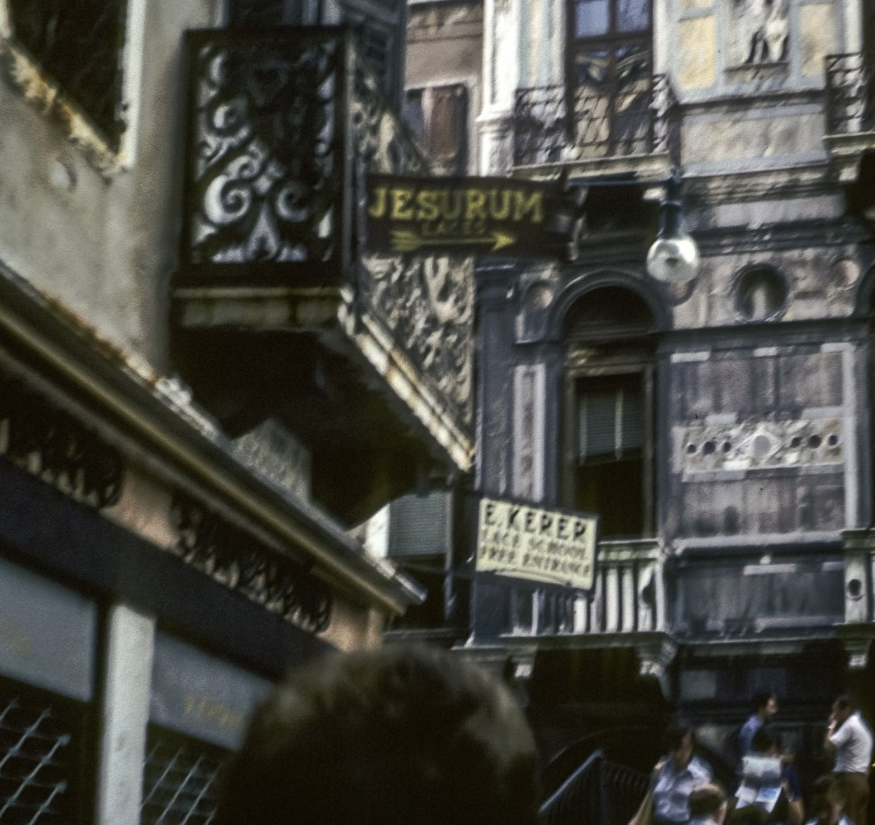 Free image of People walking through shops signs in a small alley, Italy