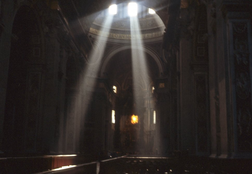 Free image of Light pouring through windows of a church tower.