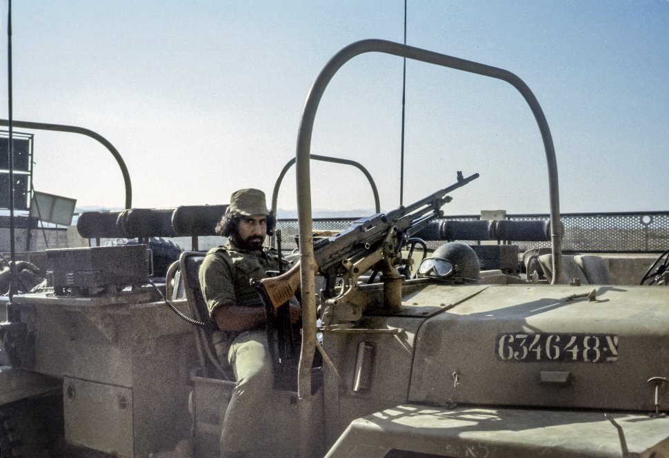 Free image of Soldier sitting in a military jeep with a large machine gun, Israel
