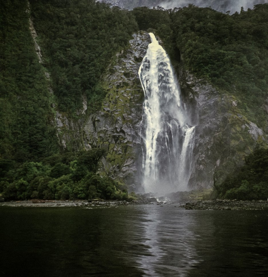 Free image of Scenic image of a waterfall and cliff.