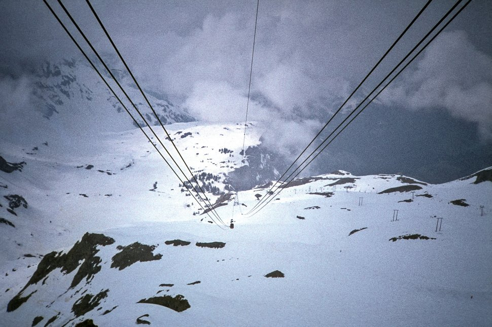 Free image of Lines for a tramway moving up a snowy mountain.