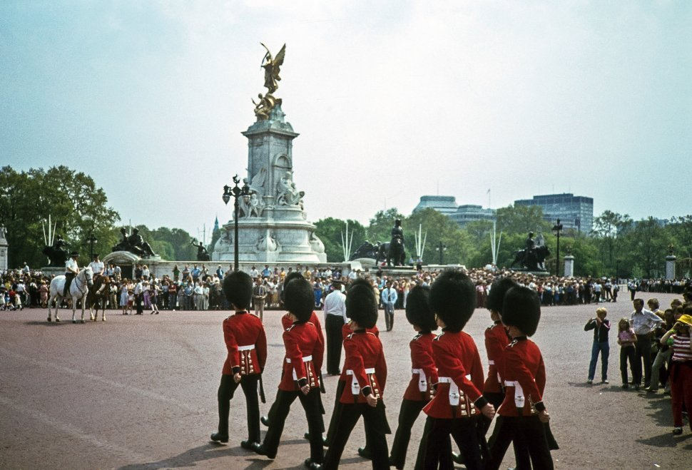 Free image of Guards marching through courtyard passed a crowd of onlookers, London, England