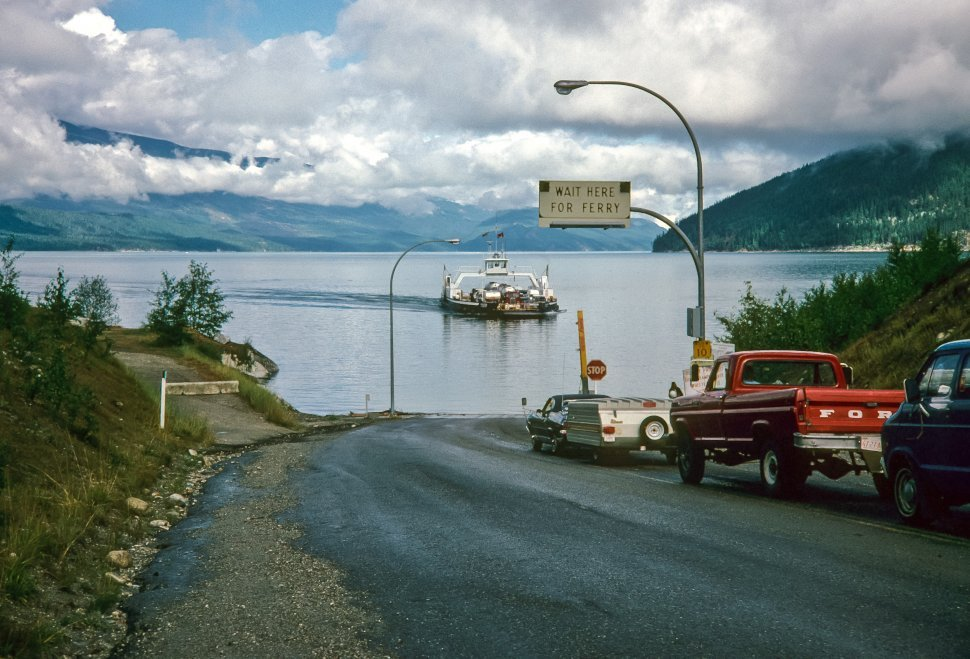 Free image of Ferry sailing away from boat dock.