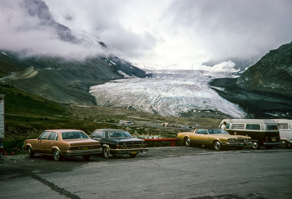 Free image of Parking lot at the bottome of a glacier ice field and mountains.