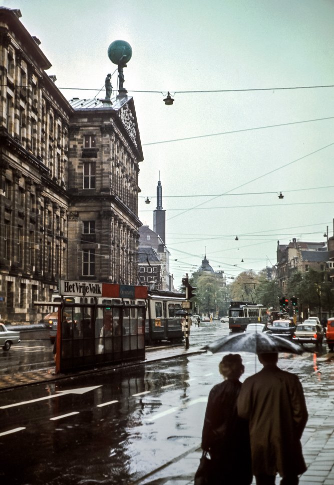 Free image of Two people walking through the streets in the rain, Europe