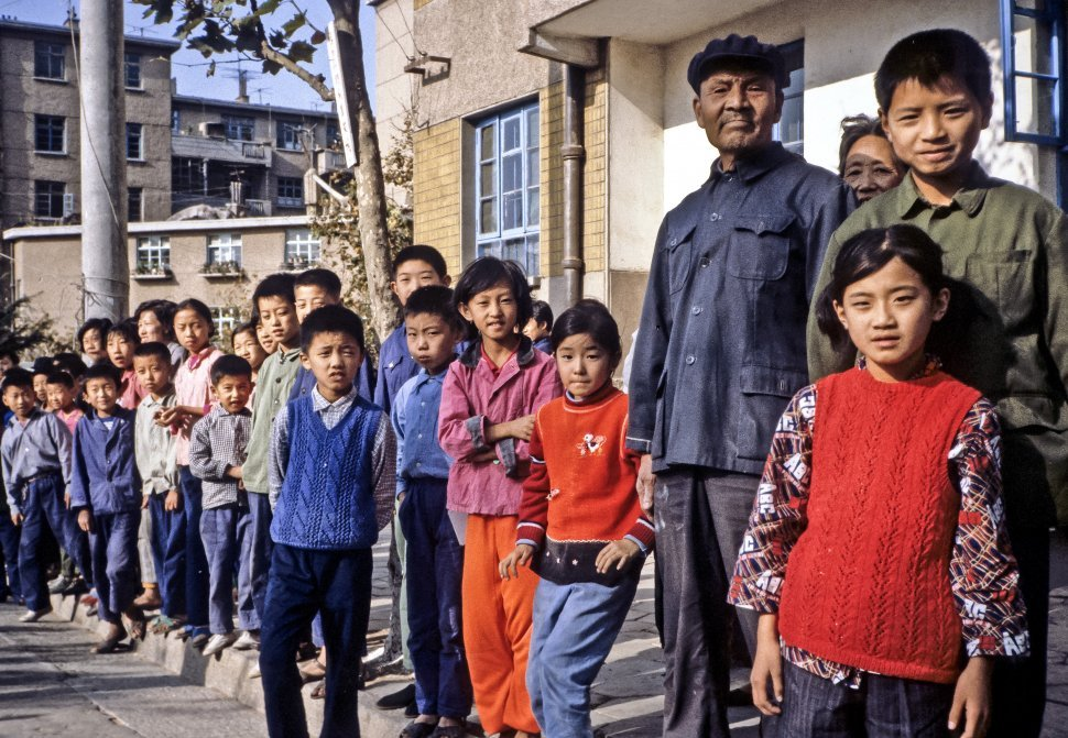 Free image of Crowd of children standing along the street, Asia