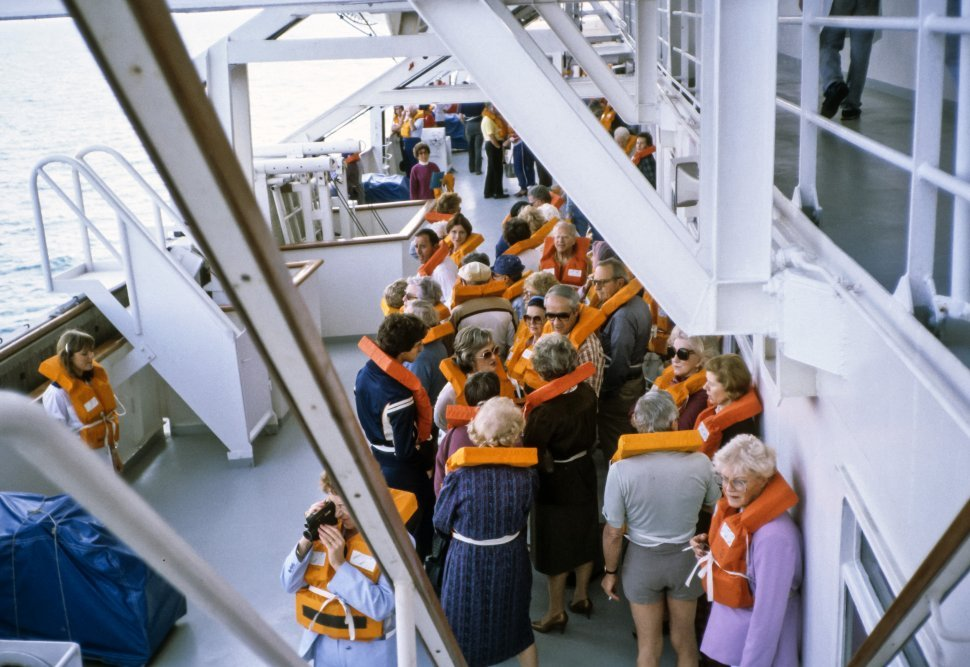 Free image of Group of tourists practicing a safety drill on a cruise ship.