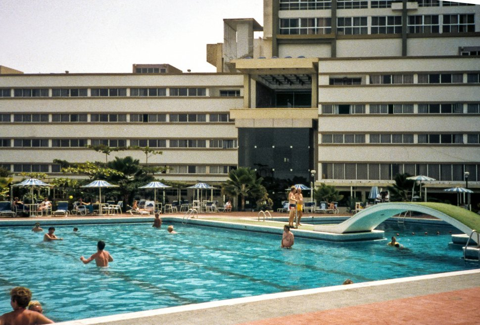 Free image of Tourists swimming in a hotel pool.