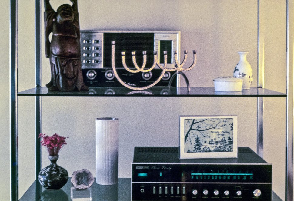 Free image of Mementos and stereo on shelves in a home.